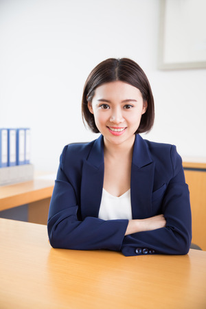 carpeta: young beautiful girl, sitting in the office began her work