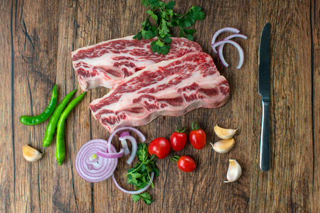raw fresh meat Steak with pepper and salt on wooden background