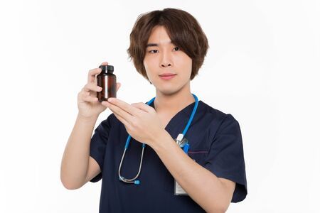 young chinese surgeon show a medicine bottle