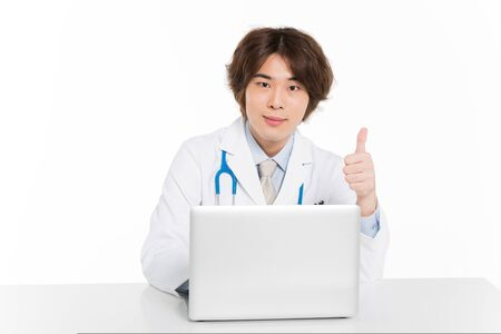 young chinese surgeon concentrate on work with thumb up