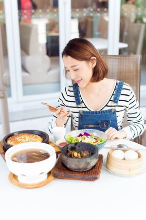 happy woman eating out in a restaurant,China. Foto de archivo