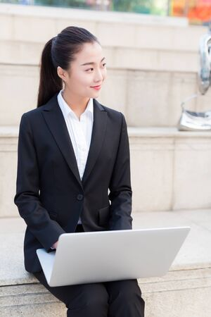 pretty girl is a civil servant, using laptop outdoors