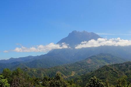 scenary: kota kinabalu mountain hill with floating cloud Stock Photo