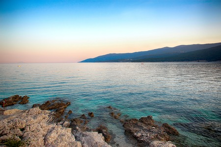 Sunset over the sea in Rabac Croatia. It is beautiful nature background. Banco de Imagens