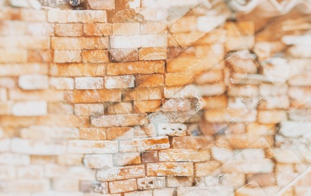 Double exposure of the stonewall from old bricks. It is retro style background or texture. Stock Photo