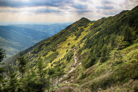 The view from mountain Krakonos and Kozi hrbety to the valley. There is Spindelurv mlyn. It is situated in Giant mountains in national park in Czech republic.