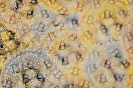Doeble exposure of Many bronze, silver and gold coins with Bitcoin sign, It is a cryptocurrency background. Bitcoin is an internet payment network and also cryptocurrency in this network.