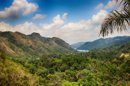 The view of river and Waterfall El- Nicho and trees and mountains in Cuba in the jungle national park. It is situated in Zapata Peninsula, Matanzas province, Cuba, Caribbean.