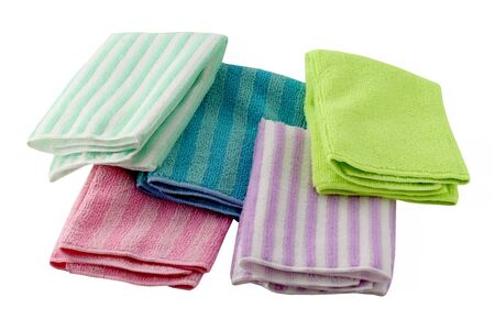 Set of microfiber dust cloths in different colors. Cloths are on a white background. They are cleaning aids.