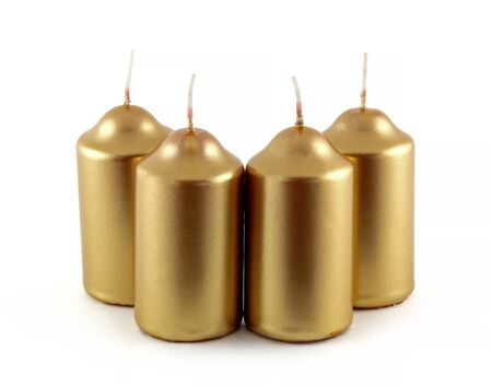 Candles in gold color. They are decorative candles. It's a set of 4 candles. 写真素材