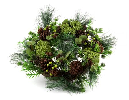 Christmas wreath from Green pine wreath with cones isolated on a white background . It is the basis for making a beautiful decorative wreath. The Xmas decorations and chain are attached to it.