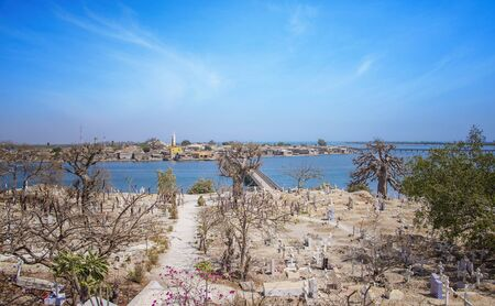 View from the hill on the island Joal-Fadiout, Senegal. Baobab trees on the Christian cemetery in Africa. There is town and long wooden bridge. Stock fotó