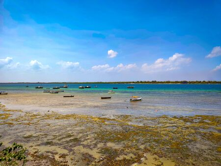 Low tide at Wasini island in Kenya, Africa. Wonderful view of the sea and small boats.