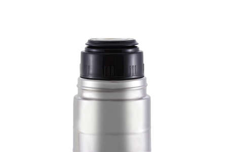 Close-up of a stainless steel  flask standing isolated on a white background. It can be used for hot tea or coffee. The lid is unscrewed. It serves as a mug.