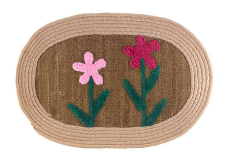 Outdoor mat in front of a door with flower decor isolated on a white background. It is an accessory of every house. Stock fotó