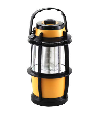 Orange electric lamp isolated on white background. It is suitable for campers, tents and cottages. It has a lot of light.