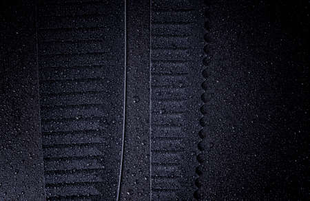 Chefs kitchen black knife blade close up on a black background. Water droplets on the knives. Banco de Imagens