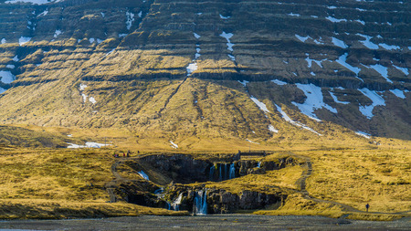 huge: Little waterfall with huge mountain in Iceland Stock Photo