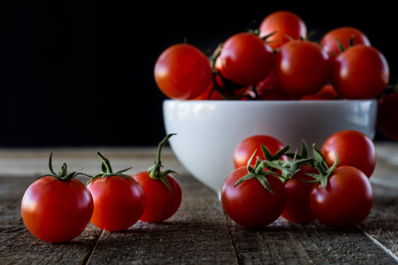 Wet tomatoes on an old table Stock Photo - 75541780
