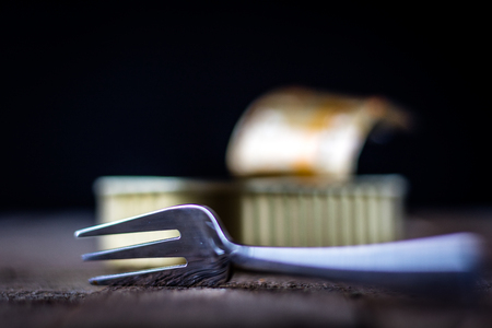sardine can: Can and fork on the table in the old kitchen Stock Photo