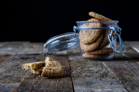 gingerbread: chocolate cookies on an old wooden table, black background