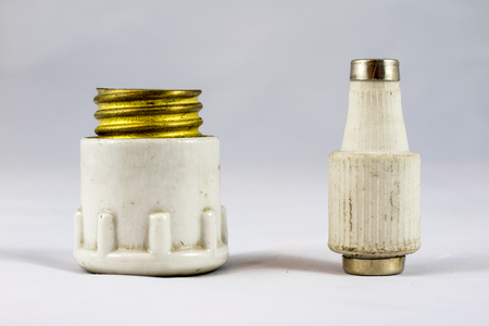Old electric fuses on white isolated background