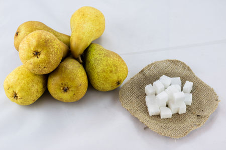 Apples, pears and sugar in diced jute with isolated background