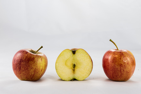 Tasty ripe apples on white isolated background