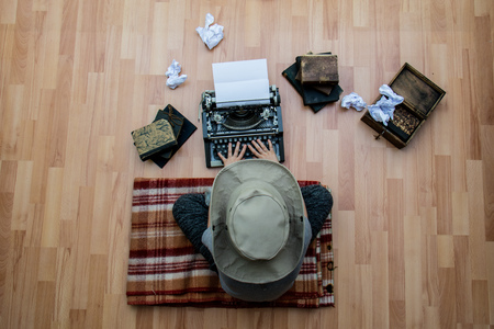 Writer while working on a new wonderful book sitting on the floor Stock Photo