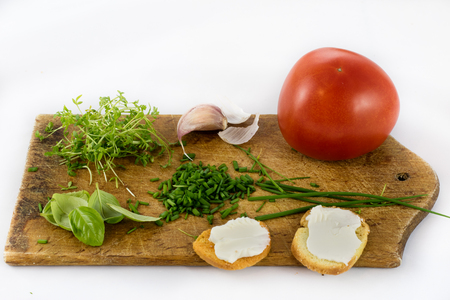 Delicious fresh spring vegetables and toasts for breakfast, white isolated background