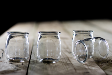 Empty jars for preserves, wooden table, black background Stock Photo