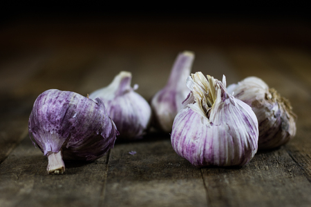 Tasty Italian garlic on a wooden table, vintage style