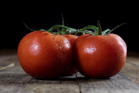 Tasty Italian tomatoes in an old kitchen on a wooden table, vintage style