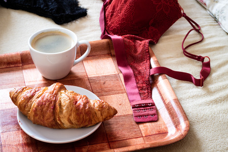bedroom: Morning, tasty breakfast to bed. Lingerie, bras and coffee. White background.