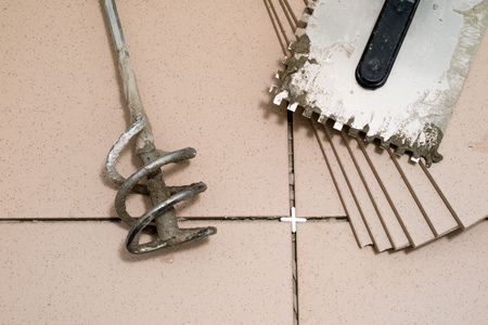 Tiling, tile trimming, metering and cutting. Repair of the floor. Sliced gres tiles. Renovated room.