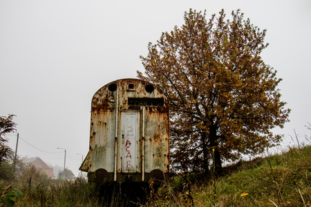 Old rusty trains. Old abandoned track, siding with dirty old trains. Old railway tracks Stock Photo