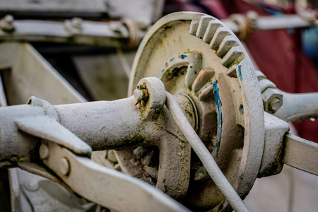 Old farm machinery on a farm. Root mechanisms and wheels in agricultural machinery from the last century. Farm. Stock Photo