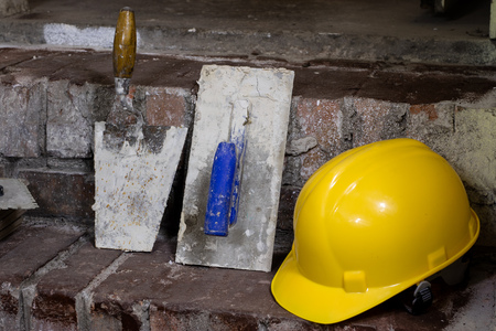 A workplace for a master from laying tiles. Tools and accessories as well as tiles when laying. Laying tiles on the stairs.