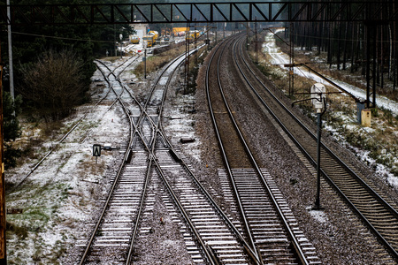 Old track at the railway station. Winter scenery of railway tracks with a passing train. Winter scenery. Stock Photo