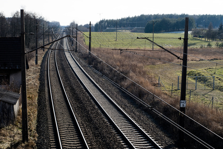 Railway line for high-speed rail trains. Railway line and electric traction, which is located above the track. Season of the spring.