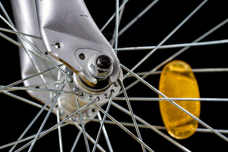 Kids bike. Shock absorber, brake, wheel shown close up. Bike accesories.
