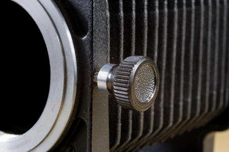 Old intermediate bellows for high-magnification photography. Photo accessories for old cameras. Dark background.