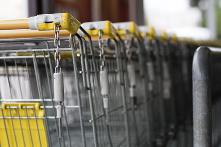 The shopping cart trolleys are placed under the market. Shopping baskets needed for shopping in large stores. Season of the spring. Stock Photo