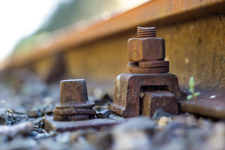 Old railway line. Fastening rails to railway sleepers. Season of the spring. Stock Photo