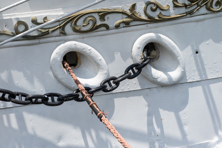 Ship mooring rope on the port wharf. Harbor bollard for large naval vessels. Season of the summer. Stock Photo