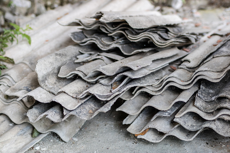 Eternit in an old farm in central europe. Old building materials used for roofing. Season of the summer. Zdjęcie Seryjne