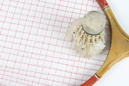 Old badminton accessories on a light table. Set for outdoor games and games. White background.