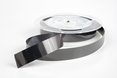 Old VHS cassette with unwound tape. Damaged data medium for old home picture and sound recording devices. White background. Stockfoto