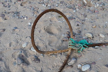 A steel rope on the sea coast. Cuma to fishing boats in central europe. Season of the autumn.