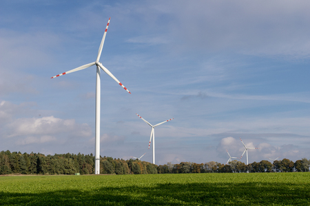 Wind farm on an open field. A windmill that generates electricity in central europe. Season of the autumn.